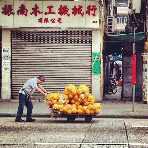 A #man pushing a #cart full of #melons heading for the #market. #hongkong #hk #hkig
