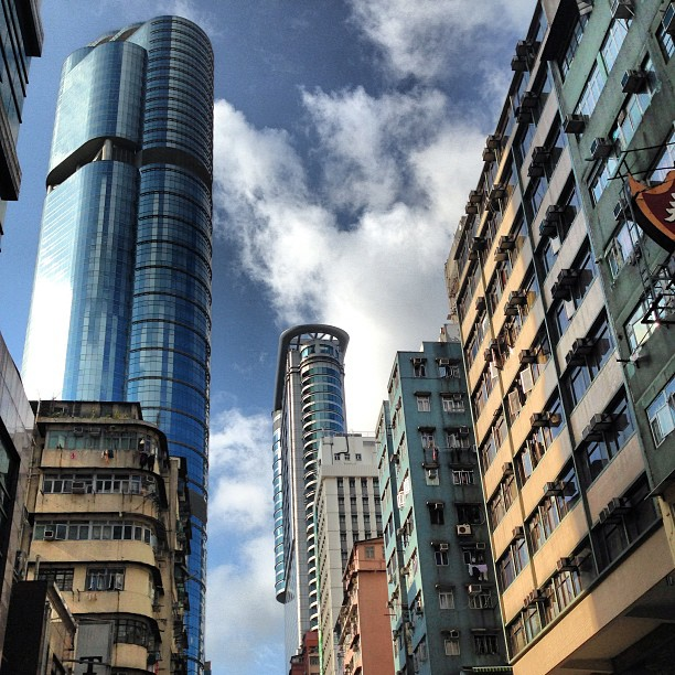Towers of #glass and #steel loom over the #old #buildings of #mongkok. #hongkong #hk #hkig