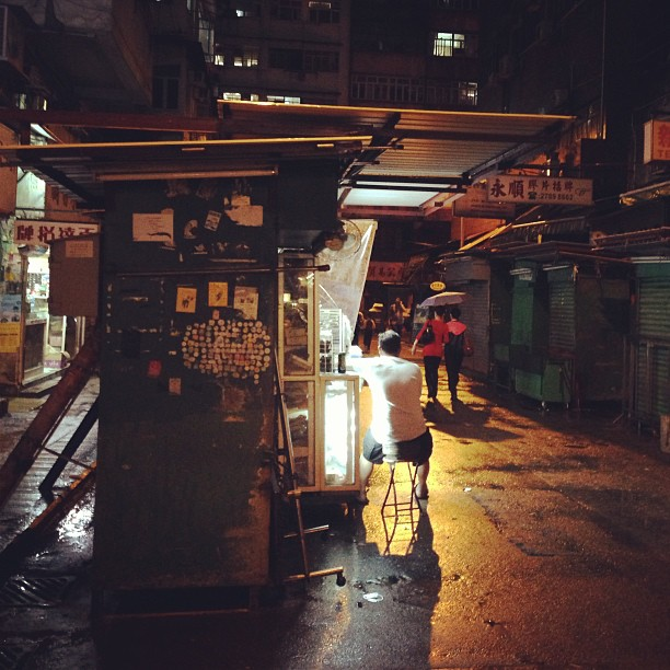 #man sitting at his #street #stall at #night. #hongkong #hk #hkig