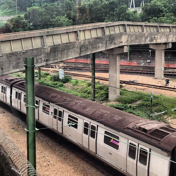 #rusting #mtr #train and an #old #concrete #pedestrian #bridge. #hongkong #hk #hkig