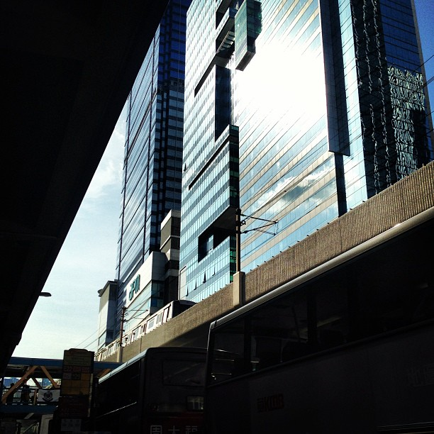 A #slice of the #city. A glimmer of #steel and #glass #buildings from the dark of the underpass. #hongkong #hk #hkig