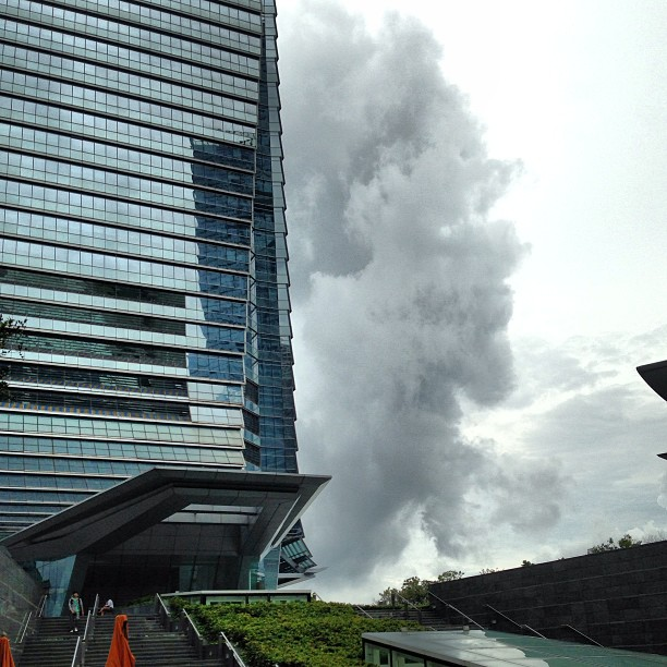 Dark #clouds billow past #ICC. #hongkong #hk #hkig #glass #steel #buildinh