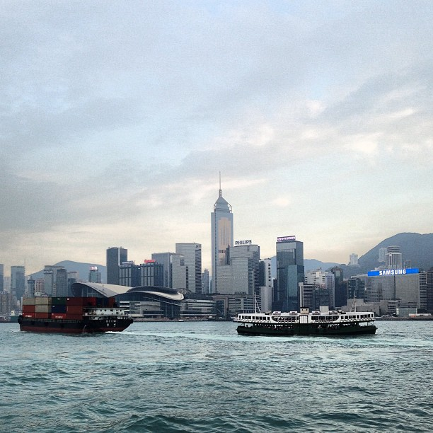 The #ferry, a #container #ship and #wanchai in the background. #hongkong in the #evening. #hk #hkig