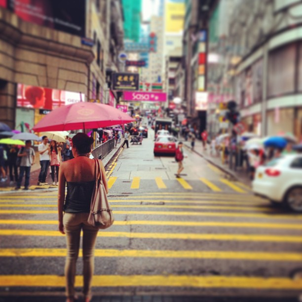 Waiting to cross - a #lady with #umbrella. #hongkong #hk #hkig