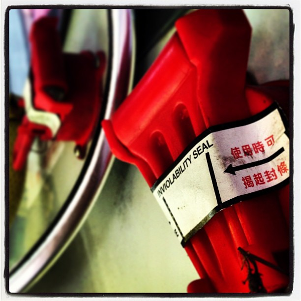 #inviolability #seal - #abstract view on a #hongkong #bus. It's the emergency escape #hammer and its #reflection in a #mirror. #hongkong #hk #hkig