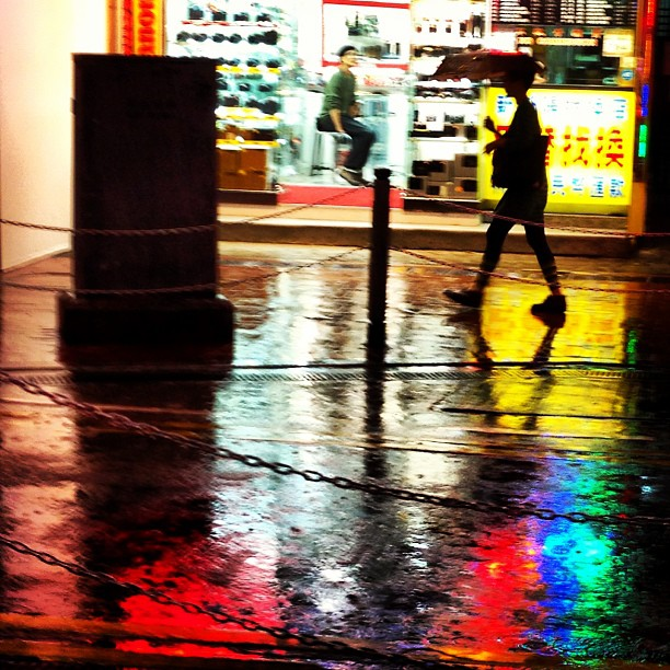 #silhouette of a #man with an #umbrella walking on the #rain soaked #streets of #causewaybay. Lovely #reflections of light on the wet street. #hongkong #hk #hkig