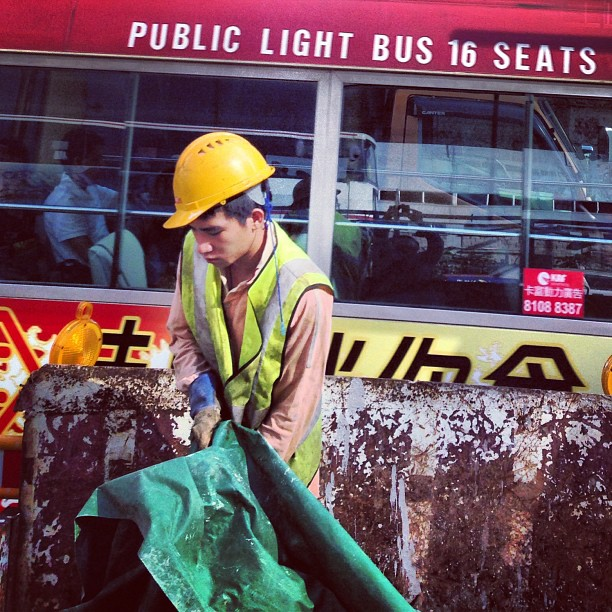 #workman performing #roadworks against a background of a public light #bus. #hongkong #hk #hkig