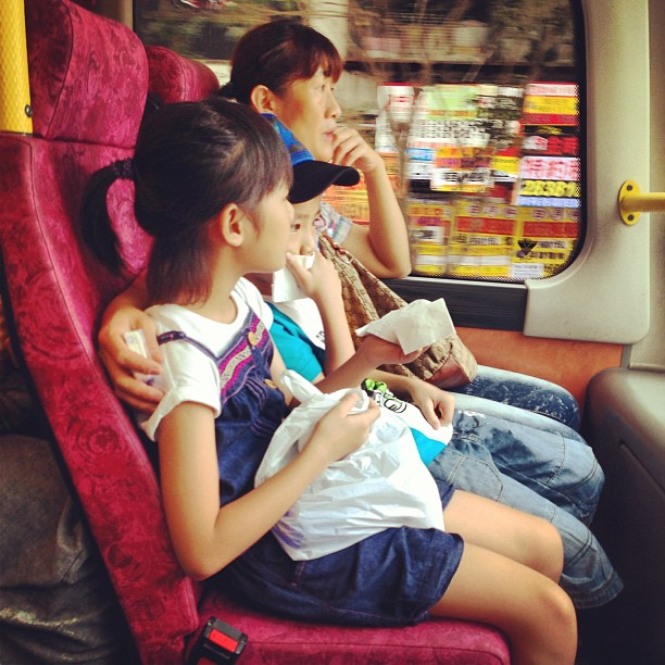 A #family rides on the #bus. A #mother and her two #children take two seats on their #commute. #hongkong #hk #hkig