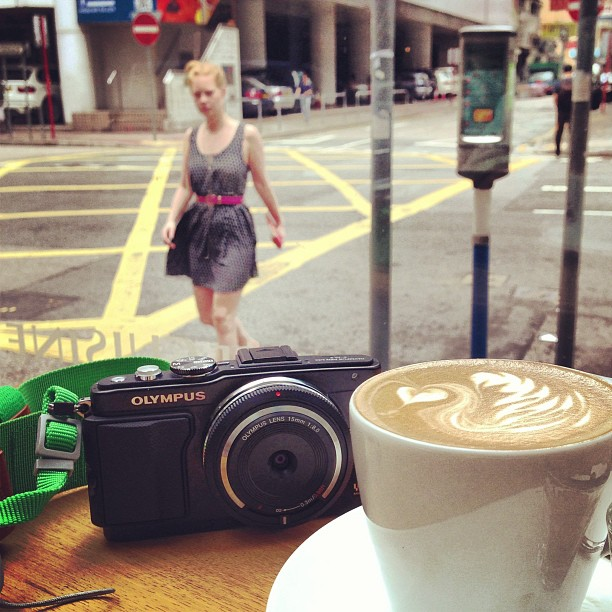 A #latte by the #street #corner in #wanchai. #hongkong #hk #hkig #coffee #olympus #camera #lady #style #cafe