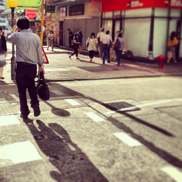 A #man #crossing a #road on a #hot #hongkong #morning. #sunlight #shadow #hk #hkig