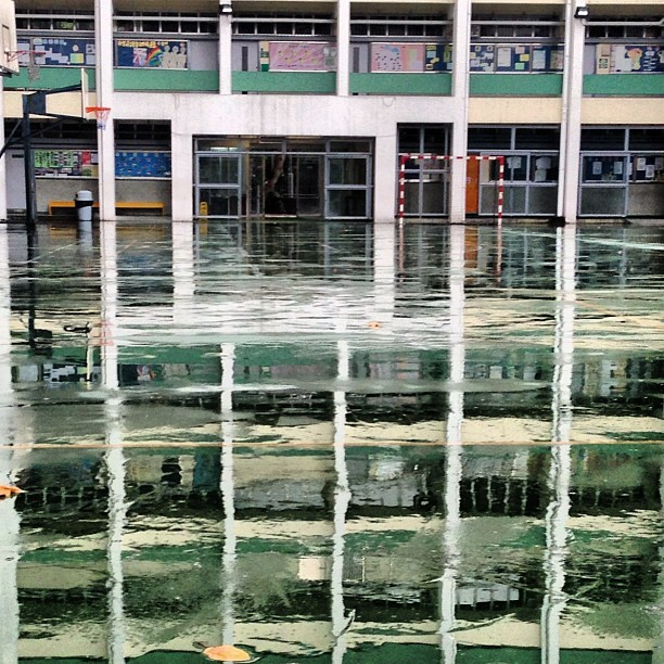 A #wet #floor on a #rainy day causes an #illusion, a #mirage of a #school #building. #reflections on #water. #hongkong #hk #hkig