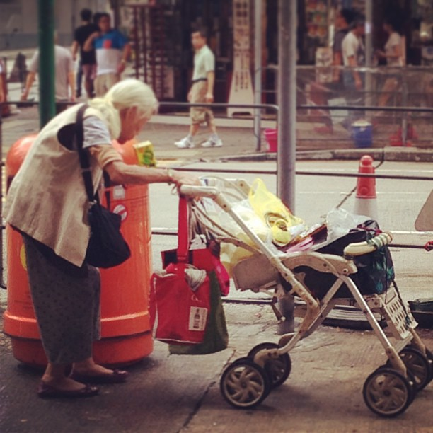 An #old #lady digs through a #trash #bin for recyclables. #hongkong #hk #hkig