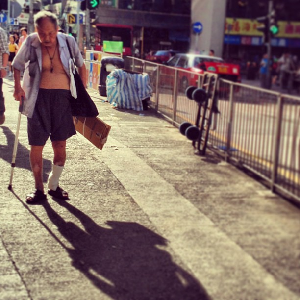 An #old #man hobbles along with walking stick casting a #shadow as long as his years. #hongkong #hk #hkig