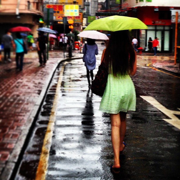 In the #morning #rain - #lady in #green with colour coordinated #umbrella. #hongkong #hkig #hk #style #fashion