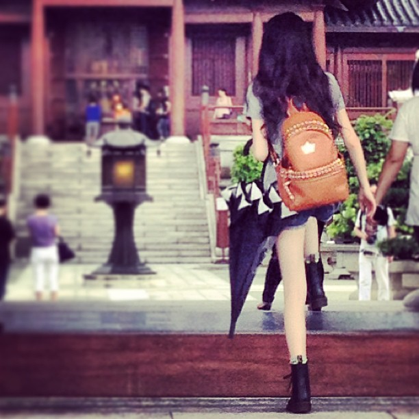 Stepping out in #style - #ladies #fashion in #hk: #black #umbrella, #studded #backpack, #denim #hotpants and #drmartens #boots. #hongkong #hkig