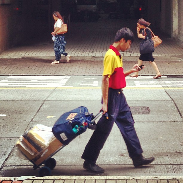 The #DHL #delivery #man makes his rounds with a #trolley. #hongkong #hk #hkig