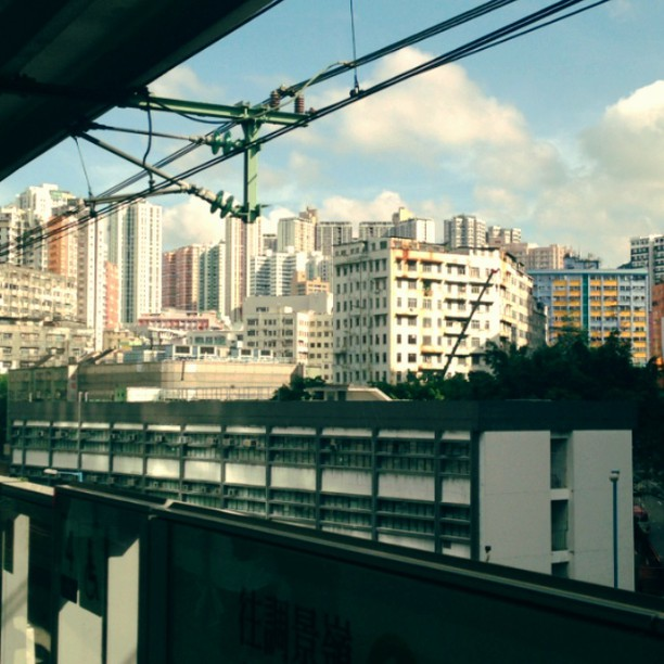 The #MTR #train pulls away from the #station revealing the #buildings in the #distance. #hongkong #hk #hkig
