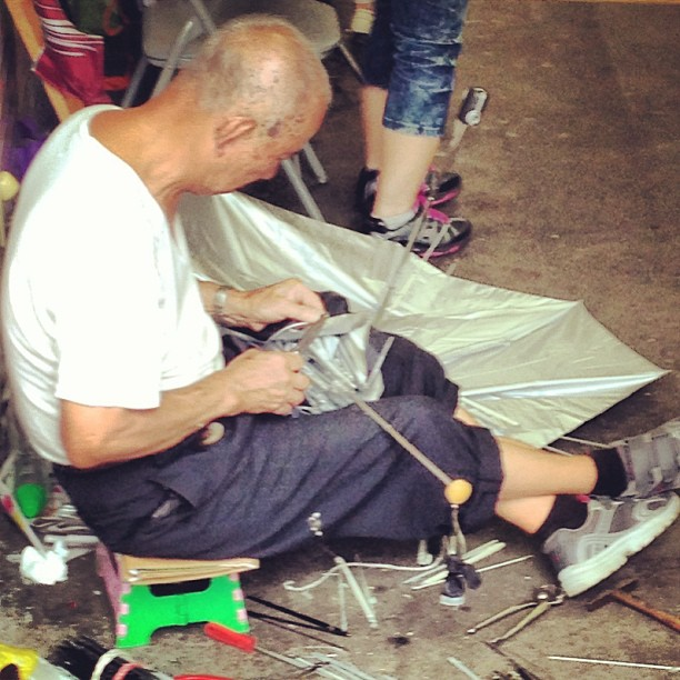 The #umbrella #mender - a dying breed today's disposable world. An #old #brolly #repair #man at work. #hongkong #hk #hkig