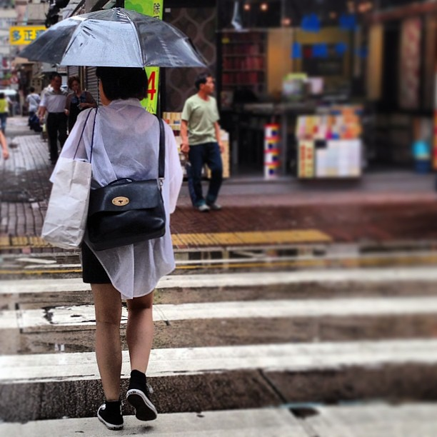 #hongkong #fashion on a #rainy day - #lady in a white / black colour-coordinated outfit. #black #bag, white #shopping bag, white #shirt, black pants, black #sneakers and black #umbrella. #style #hk #hkig