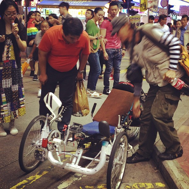 #people stop to #stare at a #man and his #recumbent #bicycle on the #streets of #mongkok. #hongkong #hk #hkig
