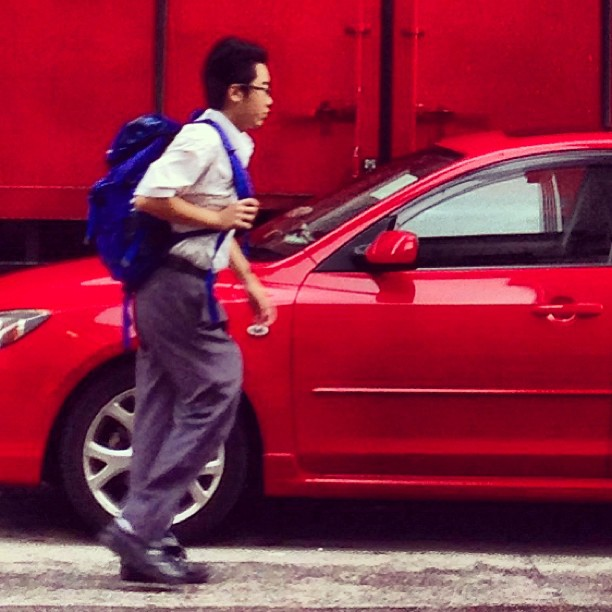 #red on red - a #school #boy rushes to school in the #morning. #hongkong #hk #hkig
