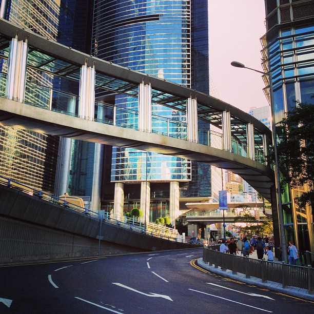 #steel #pedestrian #walkway/ #bridge over a #road between to #buildings of #glass and #steel in #central #hongkong. #hk #hkig