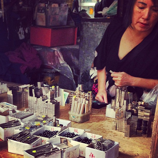 #streets of #shamshuipo - a #lady mans a #magnet #stall. Yes, they only sell magnets, how cool is that? #hongkong #hk #hkig #apliustreet