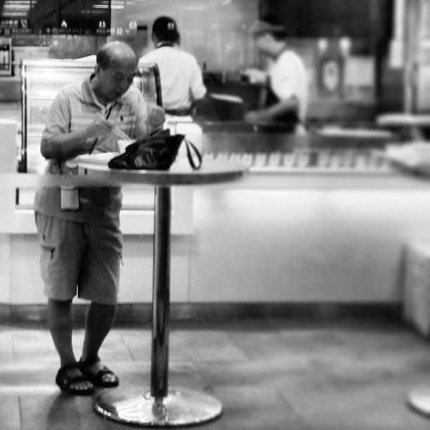 An #old #man has a #solitary #standing #lunch. #hongkong #hk #hkig