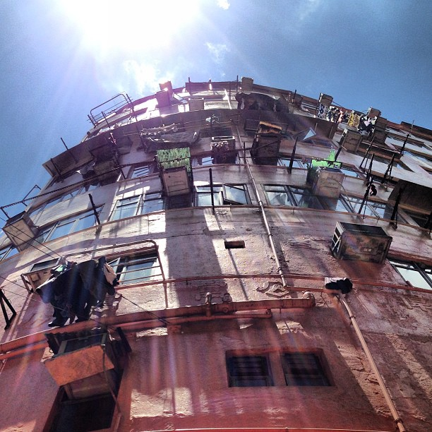 Looking #up - #sunlight #lensflare casts streaks of #light down a #tonglau / #old #building. #hongkong #hk #hkig