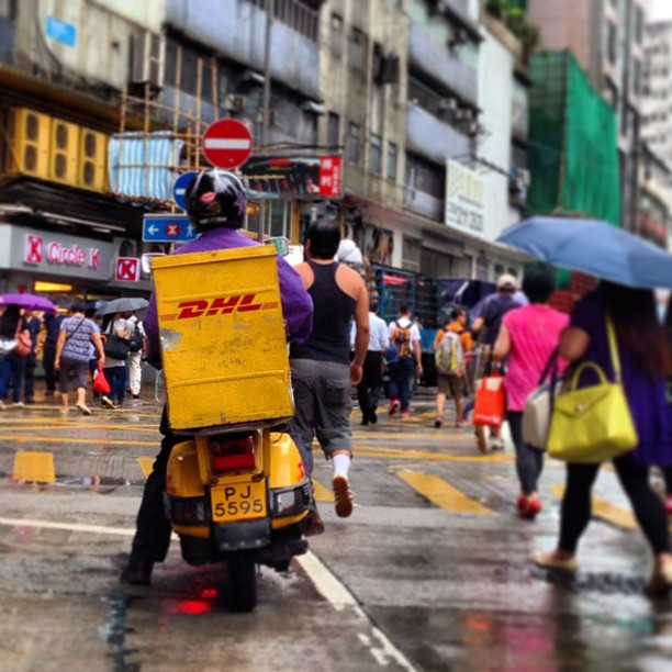 Slice of life - a #DHL #delivery #vespa on a #rainy #morning. #hongkong #hk #hkig