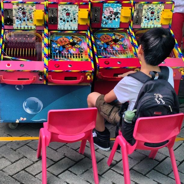 Starting them young - a #young #boy at a #pinball machine. #hongkong #hk #hkig