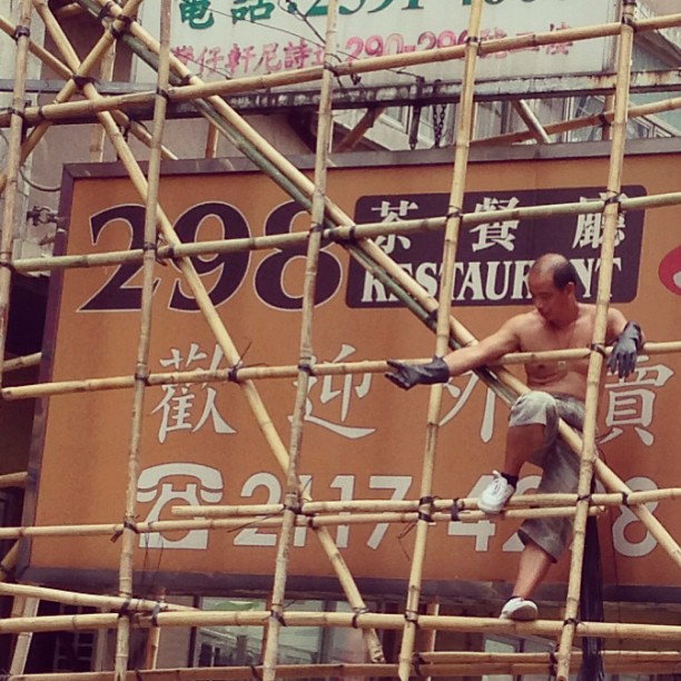 #man at work - a #worker on #bamboo #scaffolding works on a shop #sign. Uniquely #hongkong, this. #hk #hkig