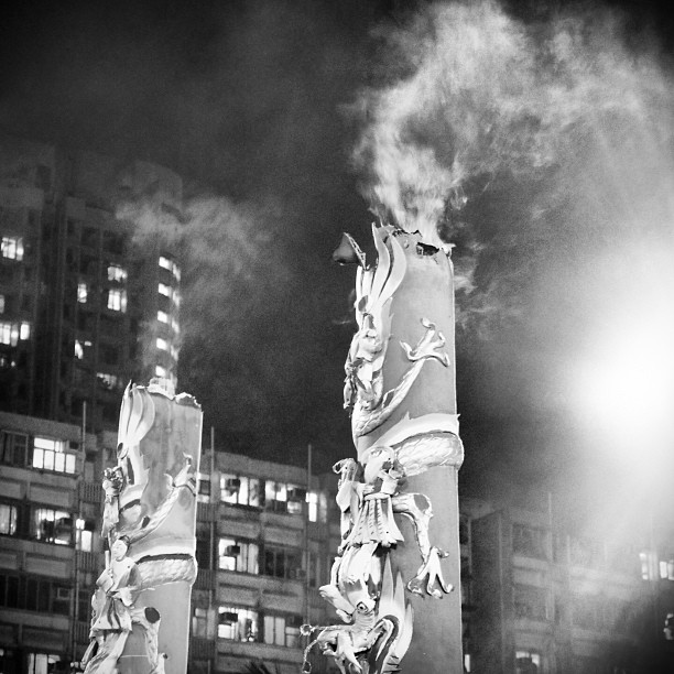 Giant sticks of #incense fill the #night sky with plumes of #smoke at a #YuLan (Hungry Ghost) festival in #ShekKipMei. #hongkong #hk #hkig #mono