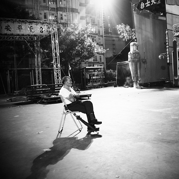 #old #man and his #shadow - an old man sits alone, watching the #YuLan opera performance from afar. #hongkong #hk #hkig