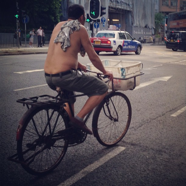 A #man on an old-school #delivery #bicycle goes about his business. #cyclist #hongkong #hk #hkig