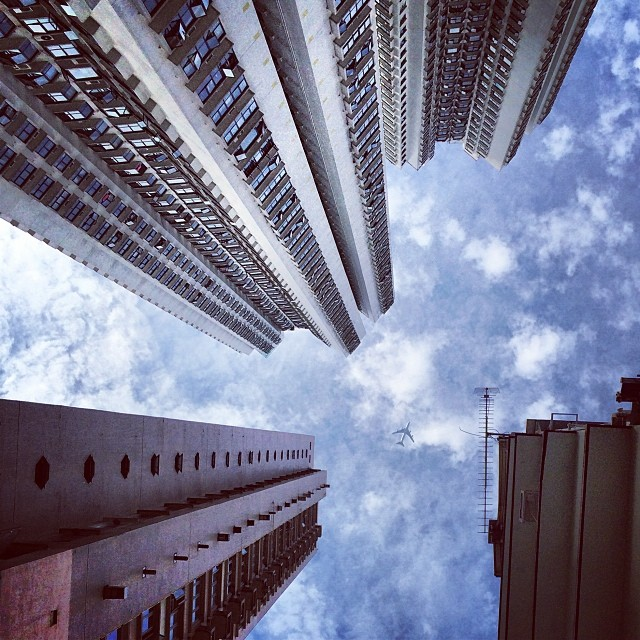 Looking up - the #apartment #buildings tower over us. Can you spot the #plane? #hongkong #hk #hkig