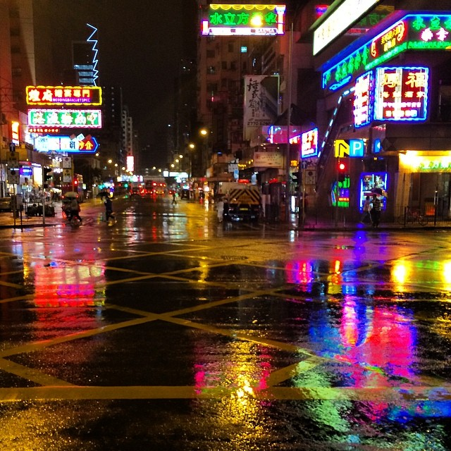 In a #night of pouring #rain, #neon #signs paint the ground in a rainbow of colours. #hkig #hkneon #hongkong #hk
