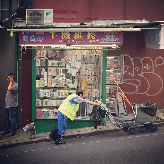 #sheungwan #street #life - a street #sweeper pushes his cart up the hilly streets past a small mobile repair #kiosk. #hk #hongkong #hkig