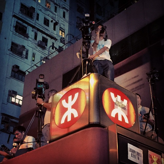 Contrary to popular belief, the revolution WILL be televised - a #cameraman perched on top a #Mongkok #MTR station exit, filming the ongoing #OccupyHK protests. #HongKong #hk #hkig