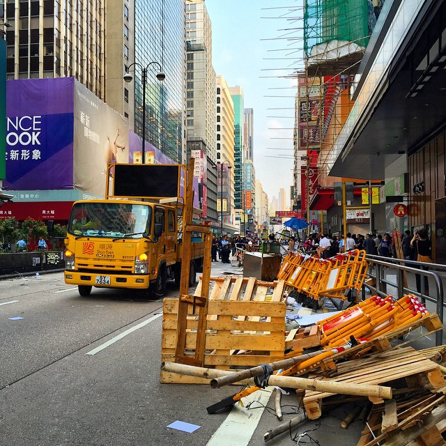 A dawn raid on #OccupyHK #Mongkok has cleared out #NathanRoad. #trucks removed the #barricades and heavy riot police presence ensured that it was done swiftly. #HongKong #hk #hkig