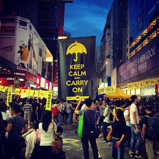 A giant #KeepCalmAndCarryOn #banner on #NathanRoad in #Mongkok draws a lot of attention from the crowd. #OccupyHK #HongKong #hk #hkig