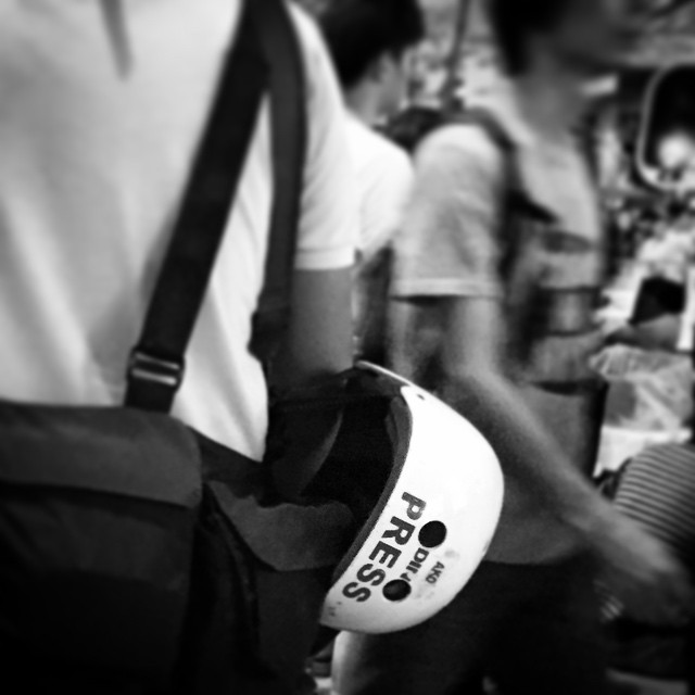A #press #helmet - did this photographer make one for #OccupyHK or have #HongKong demonstrations been so bad that it's part of the standard kit? #HongKong #hk #hkig #mono