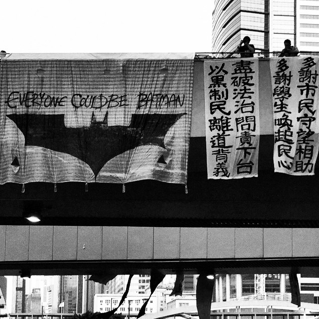 An #OccupyHK banner hanging from an overhead walkway in #Admiralty - Everyone Could Be #Batman. #mono #HongKong #hk #hkig
