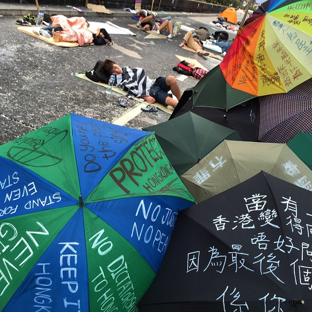 An #umbrella art installation watches over #protesters sleeping on #NathanRoad in #Mongkok on day 12 of #OccupyHK. #umbrellarevolution indeed. #HongKong #hk #hkig