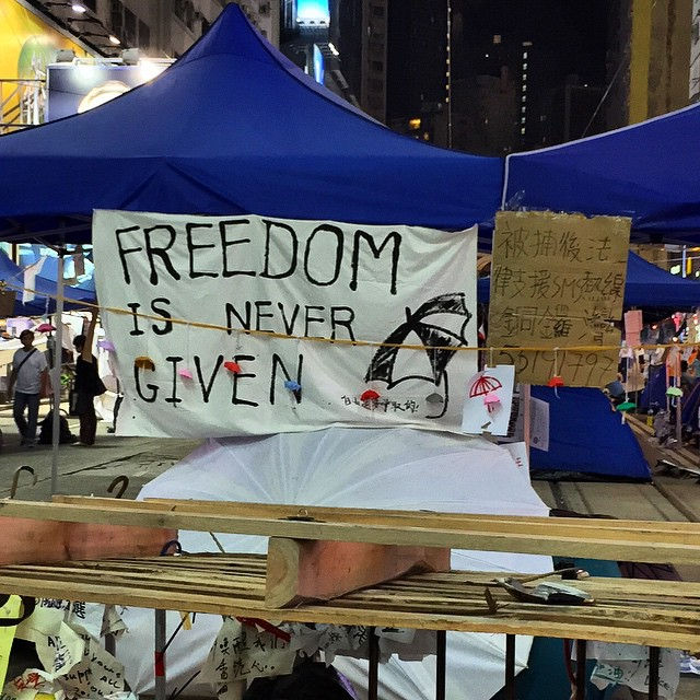 An #umbrellarevolution / #OccupyHK sign from #CausewayBay - Freedom is Never Given. Unfortunately a truism. No authority has ever relinquished any form of control without a fight be it a legal challenge, a protest or otherwise. #HongKong #hk #hkig