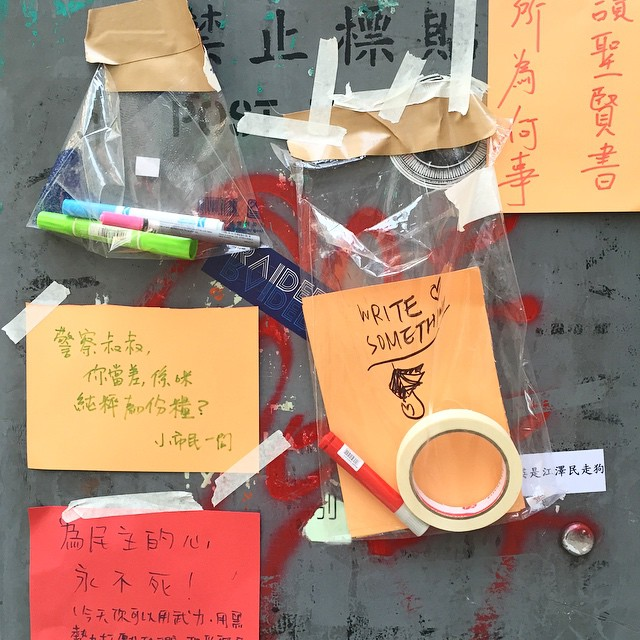 At #OccupyHK in #CausewayBay, an electric box has been turned into an impromptu messageboard. Sticky tape, papers and markers have been left for people to leave messages for others to read. #HongKong #hk #hkig
