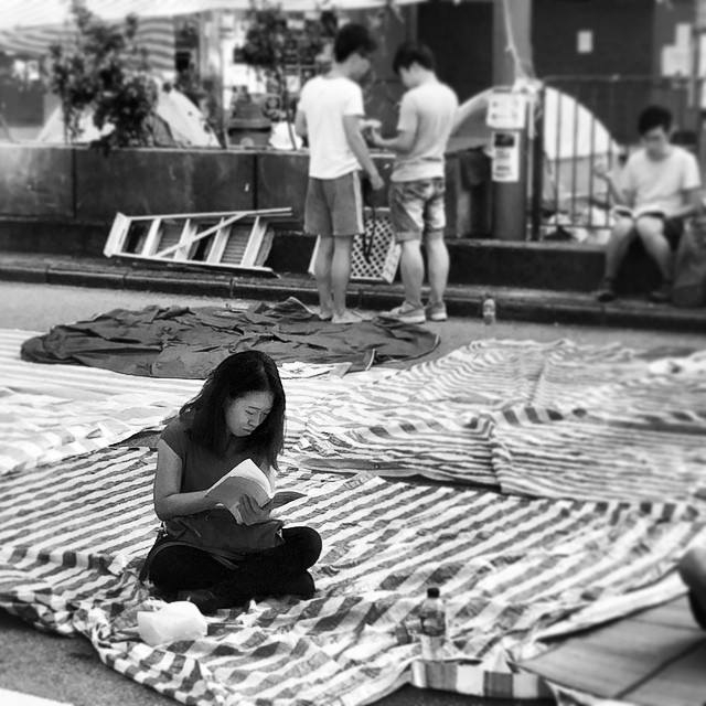 Dawn on day 10 of #OccupyHK in #Mongkok finds a #protester #reading. Honestly, these are likely the most well-read protesters ever. #HongKong #hk #hkig #mono