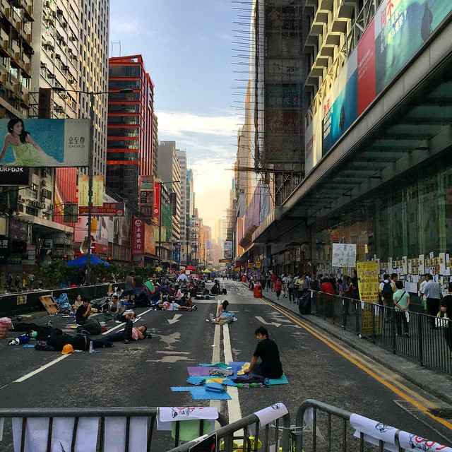 Day 22 of #OccupyHK in #Mongkok - #dawn finds #NathanRoad still occupied despite dwindling protester numbers. #perspective shot. #HongKong #hk #hkig