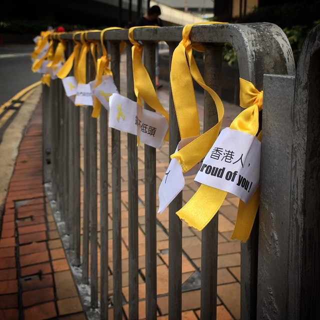Dozens of #OccupyHK #YellowRibbons with supportive messages tied to a railing along the side of the #road in #Admiralty. #HongKong #hk #hkig