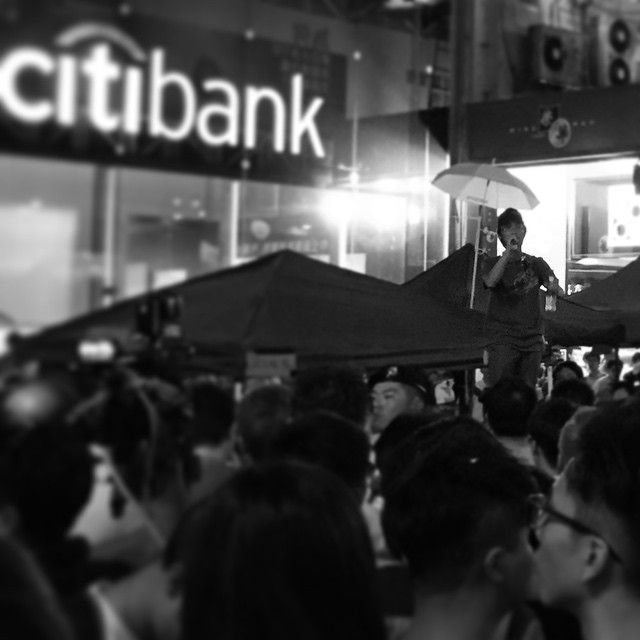 #OccupyHK in #Mongkok is torn in two. The official movement has called for a withdrawal from Mongkok to consolidate in Admiralty. However, perhaps proving that this movement has no leaders, the Mongkok crowd refuses to disperse. They are now publicly debating whether to leave or not. There's heavy police presence here now. I fear if they do not leave things will escalate. #mono #HongKong #hk #hkig